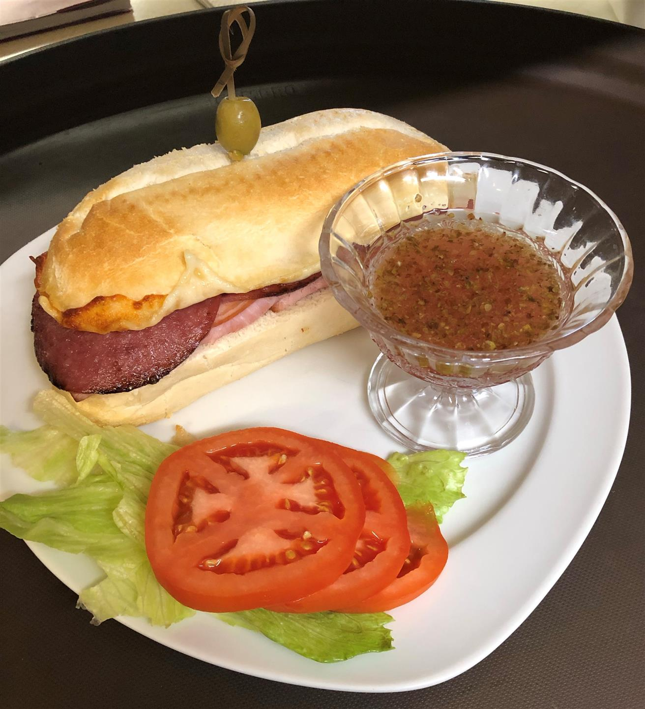 Ham, salami, provolone cheese, lettuce and tomato served oven toasted sandwich with tomatoes and lettuce on the site
