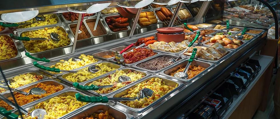 Buffet section with an assortment of trays with hot foods