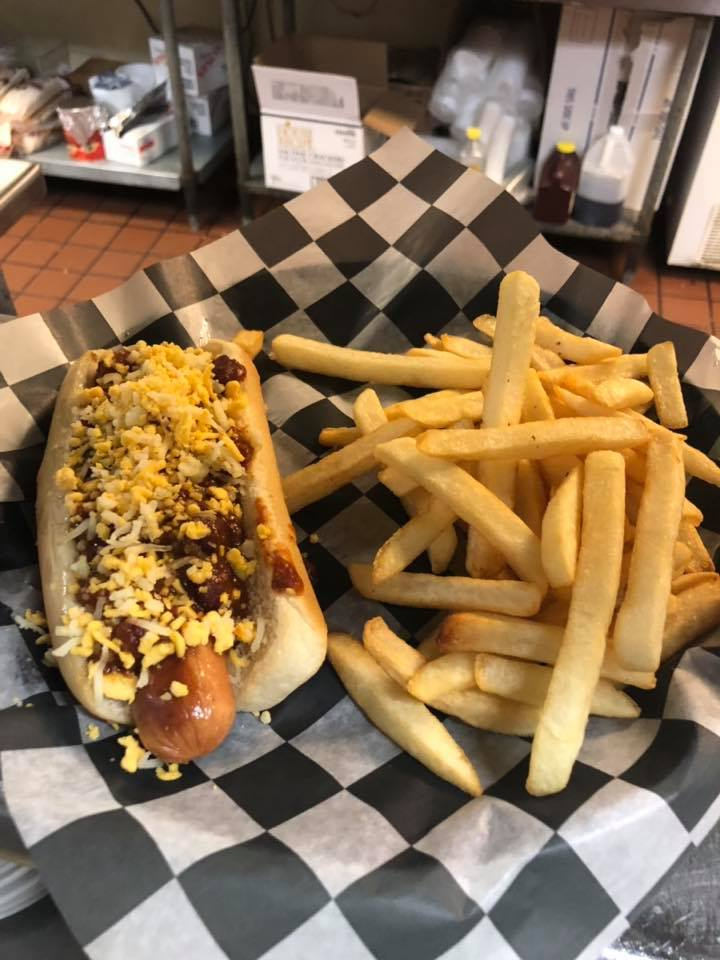 Loaded chili hot dog with cheese and fries