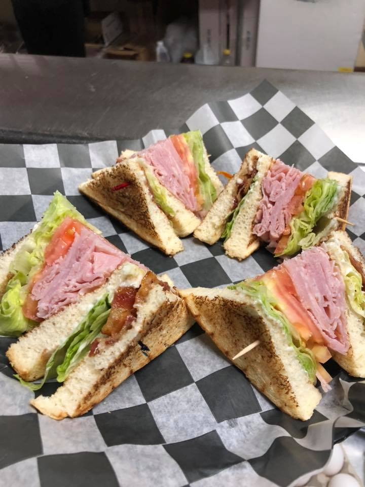 Ham club sandwich with lettuce, tomato and bacon