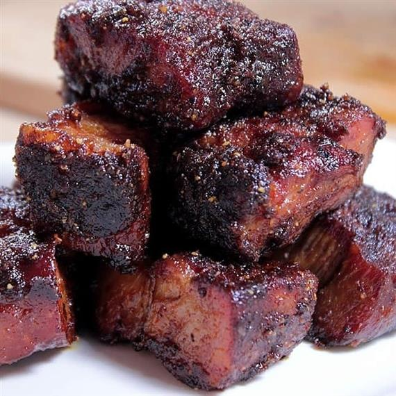 burnt ends stacked together on a countertop