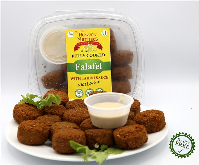 falafel in a container and falafel out ona plate with dipping sauce