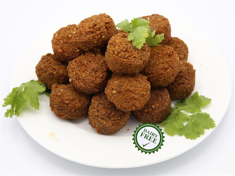 a pile of falfel on a plate