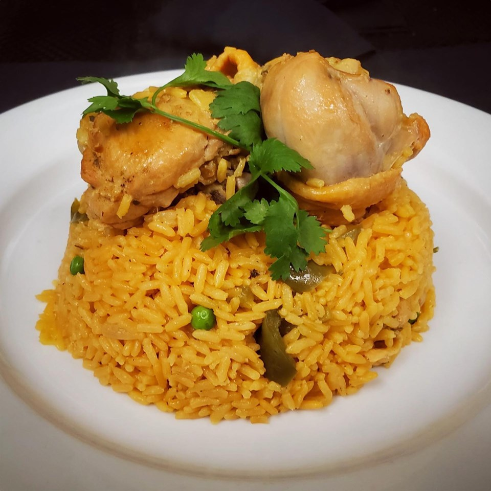 fried rice topped with grilled chicken and parsley