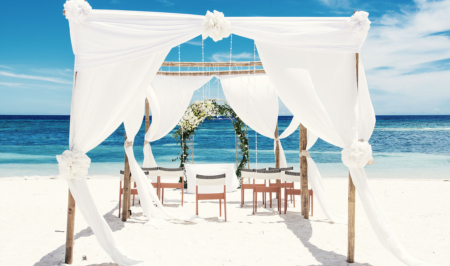 wedding canopy set upon the beach