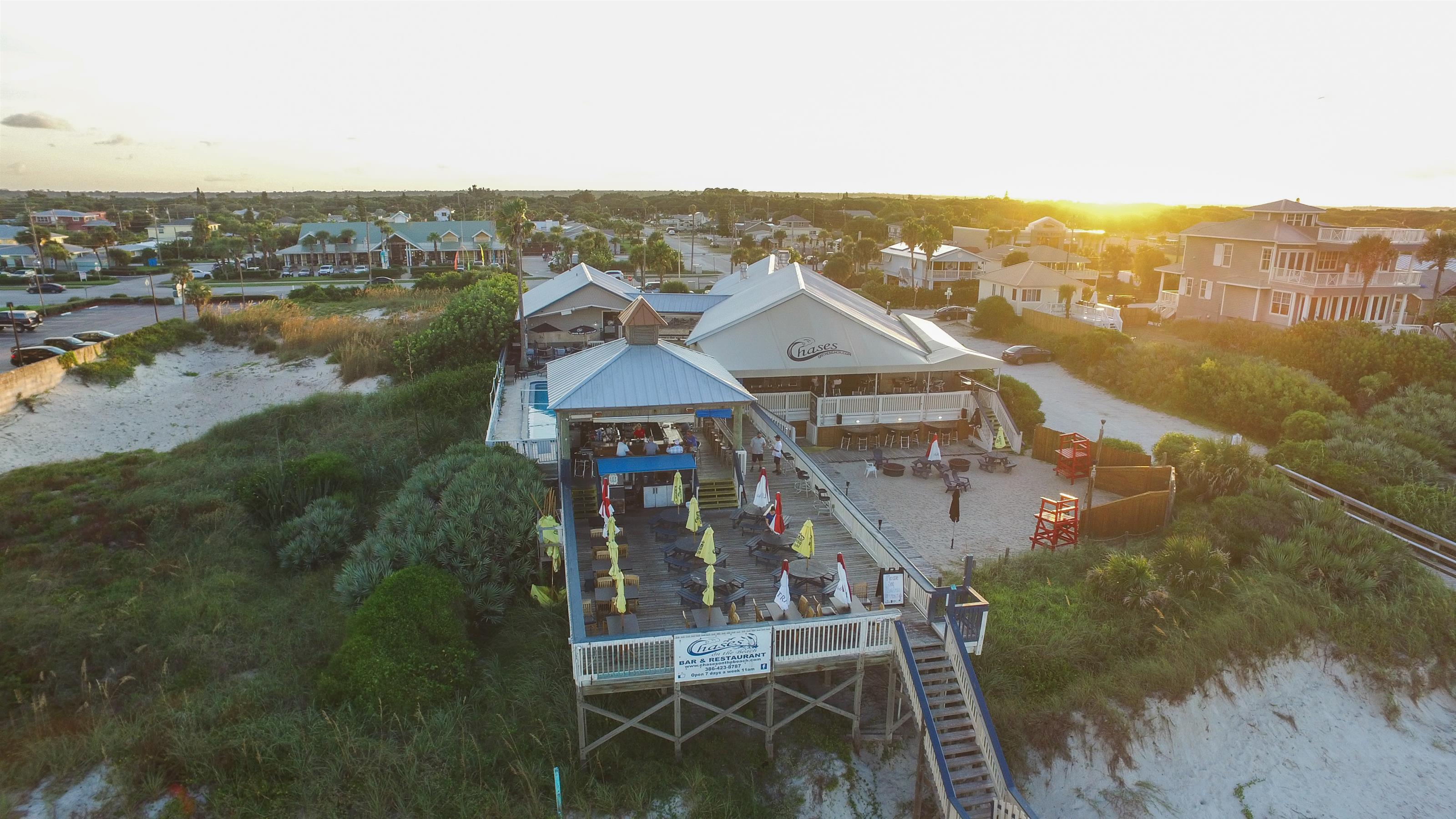 aerial view of chase's on the beach back patio with view of the beach