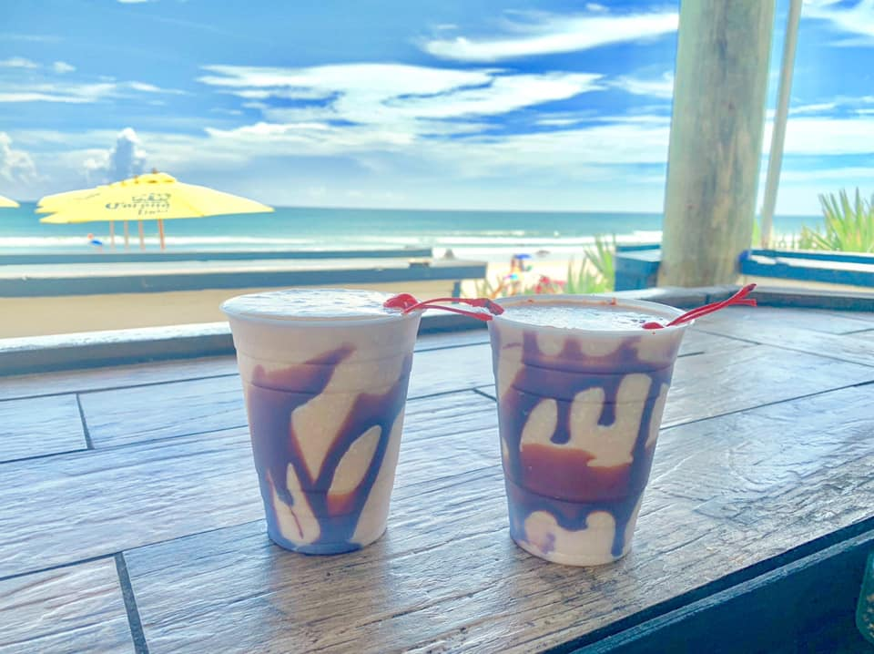 2 mudslides on the outdoor tables with view of the ocean