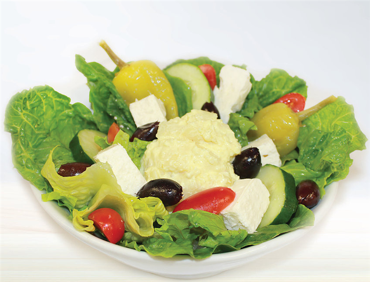 Greek Salad. Lettuce, tomatoes, cuccumbers, olives, feta cheese, and hummus.