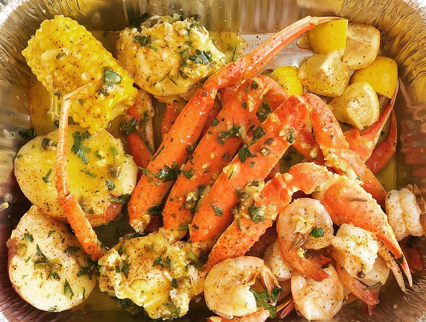 snow crab legs, shrimp and corn on the cobb tossed in garlic sauce.
