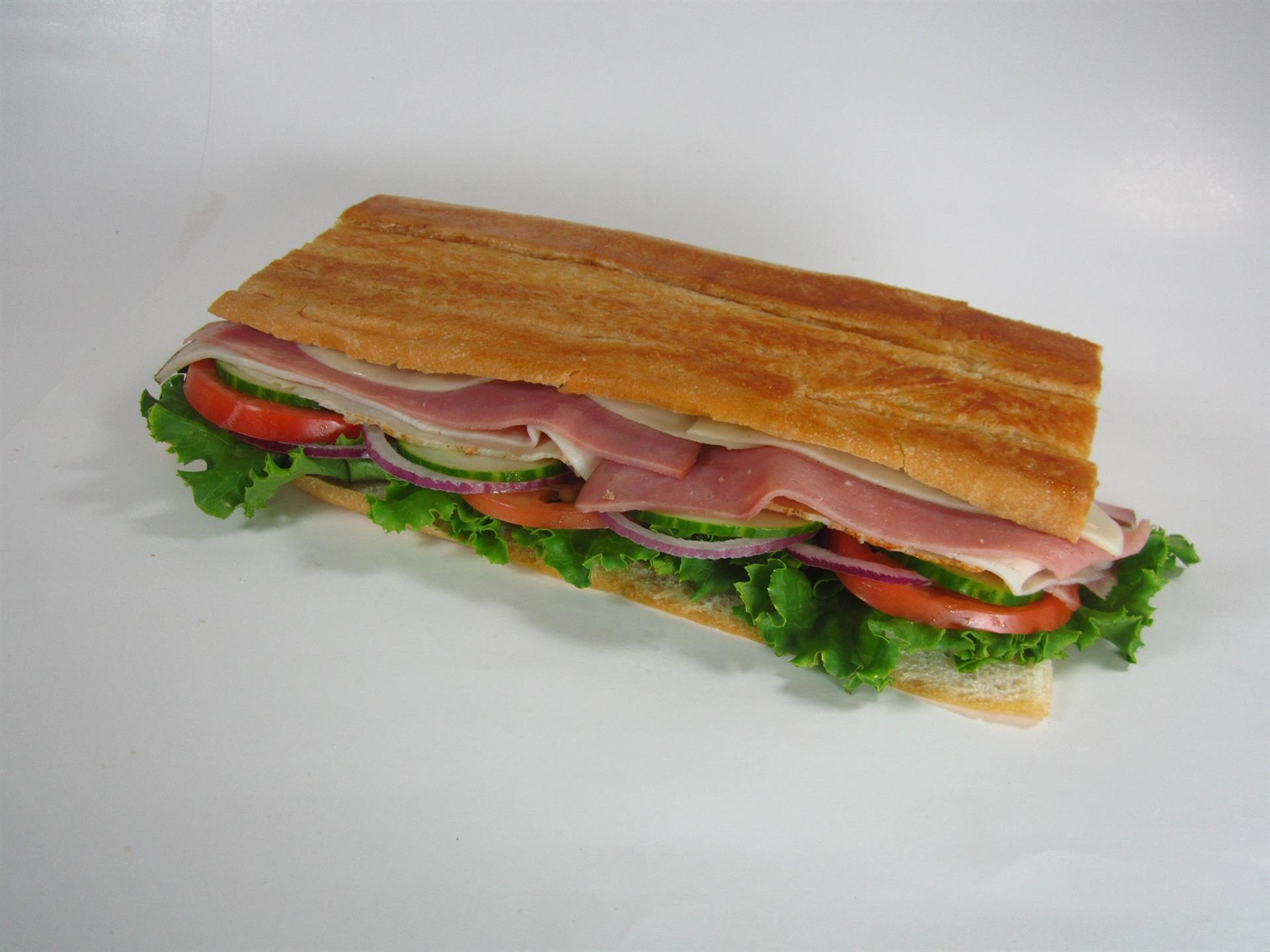 Cuban Sandwich with lettuce, tomato, onion, meat and cheese