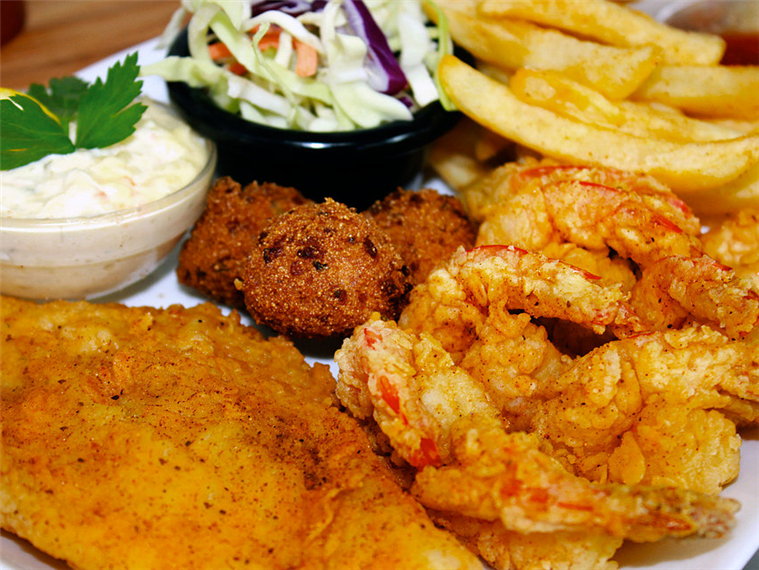 Seafood Dinner. Fried Fish, Fried Shrimp, Coleslaw, french fries and Hushpuppies