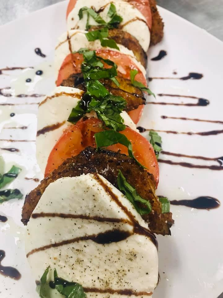 Mozzarella, fried eggplant and sliced tomatoes with basil and drizzled balsamic