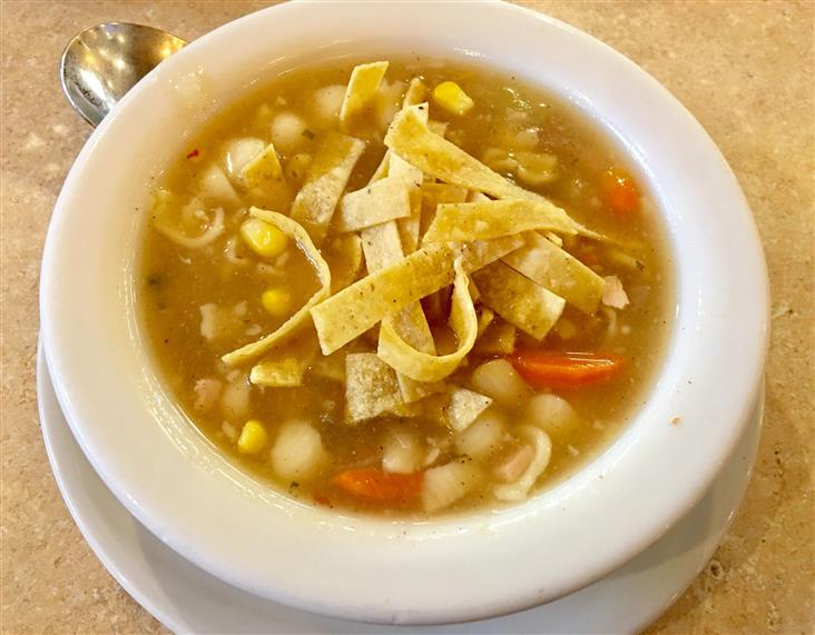 chicken noodle soup topped with crispy tortilla strips