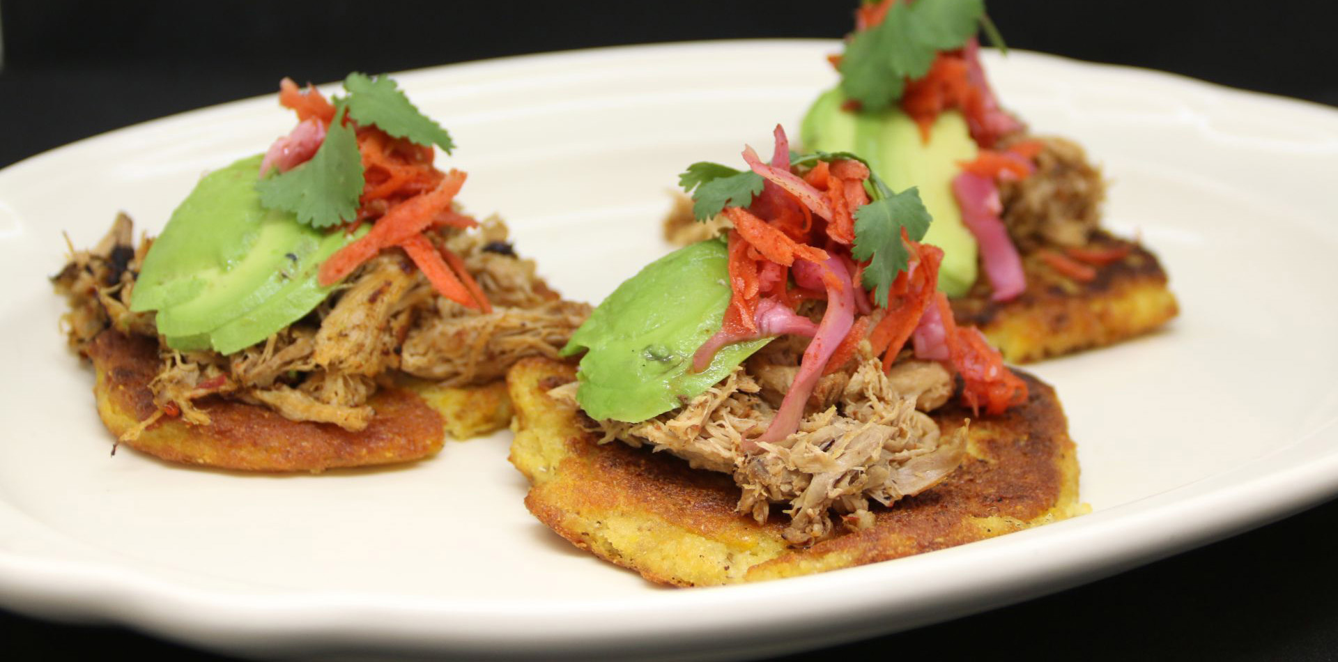 pulled pork tacos with  avocado, pickled red onion, and cilantro