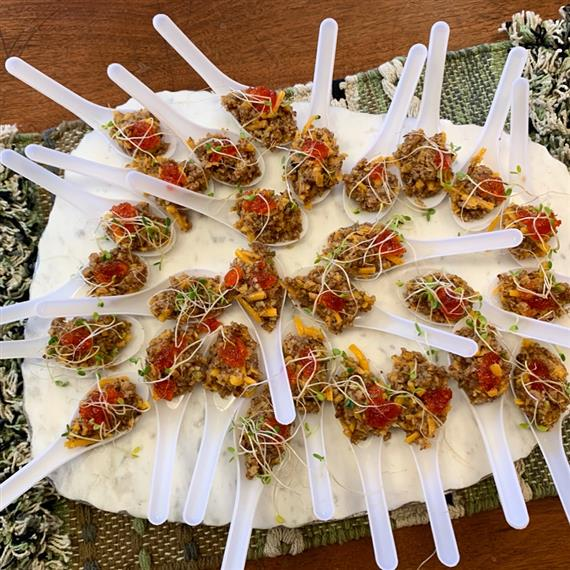 tuna tartar appetizers on display for an event