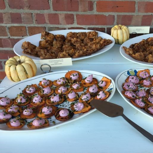platters on display for catering event with small bite plates