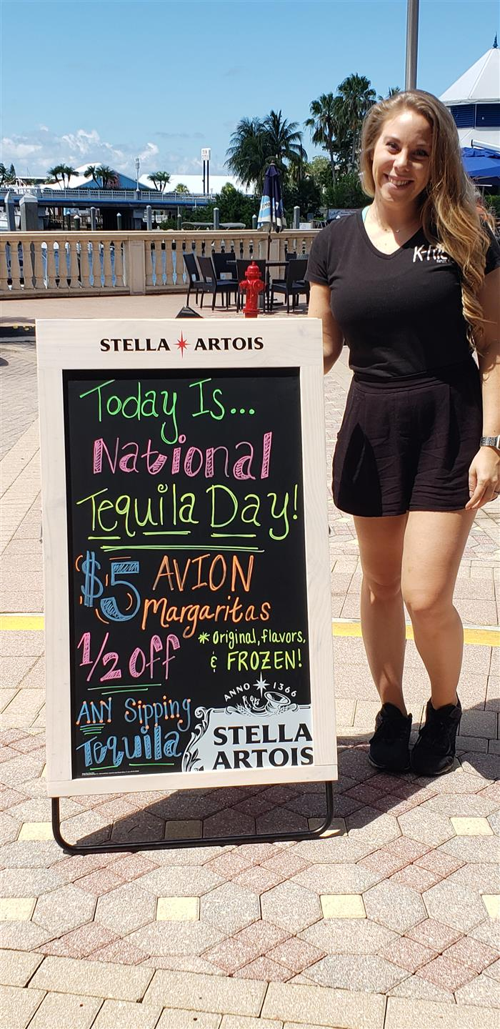 chalkboard sign with national tequila day specials