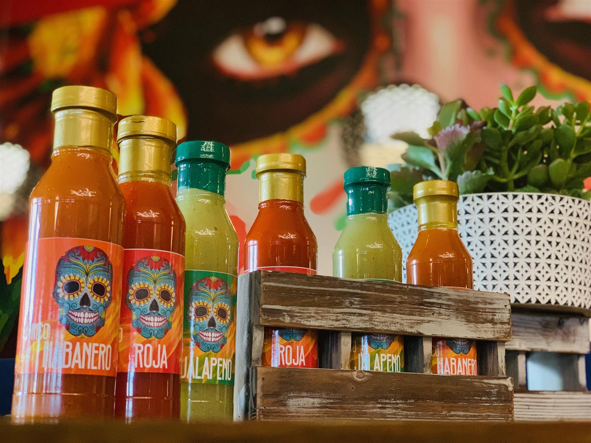 shot of hot sauce bottles lined up on a ledge