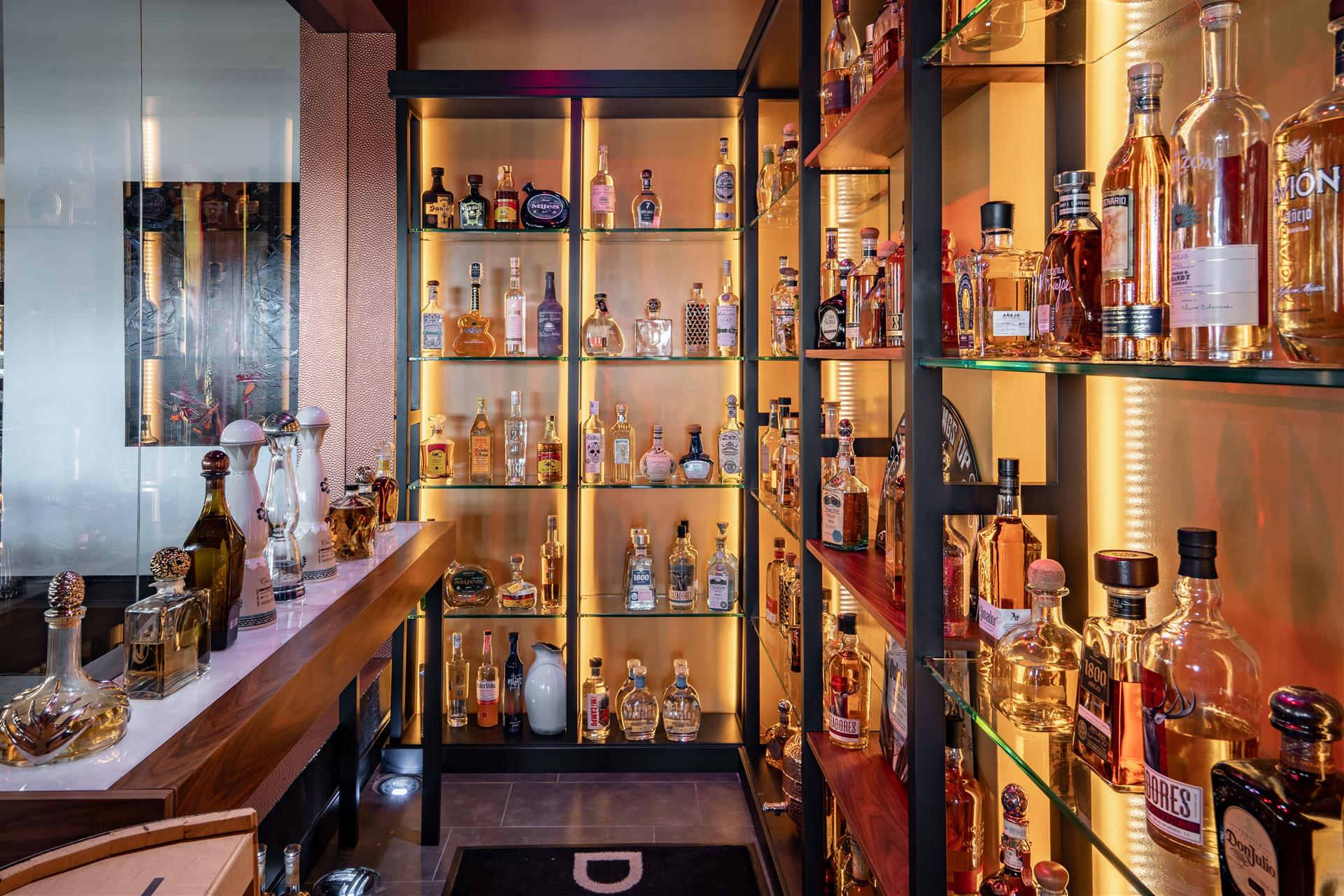 tequila cellar with shelves filled with bottles of alcohol