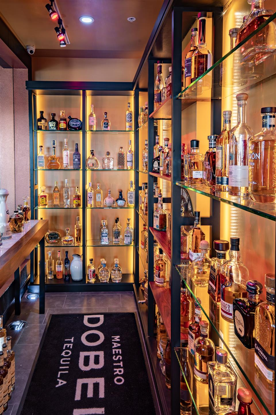 Tequila cellar, shelves with alcohol bottles