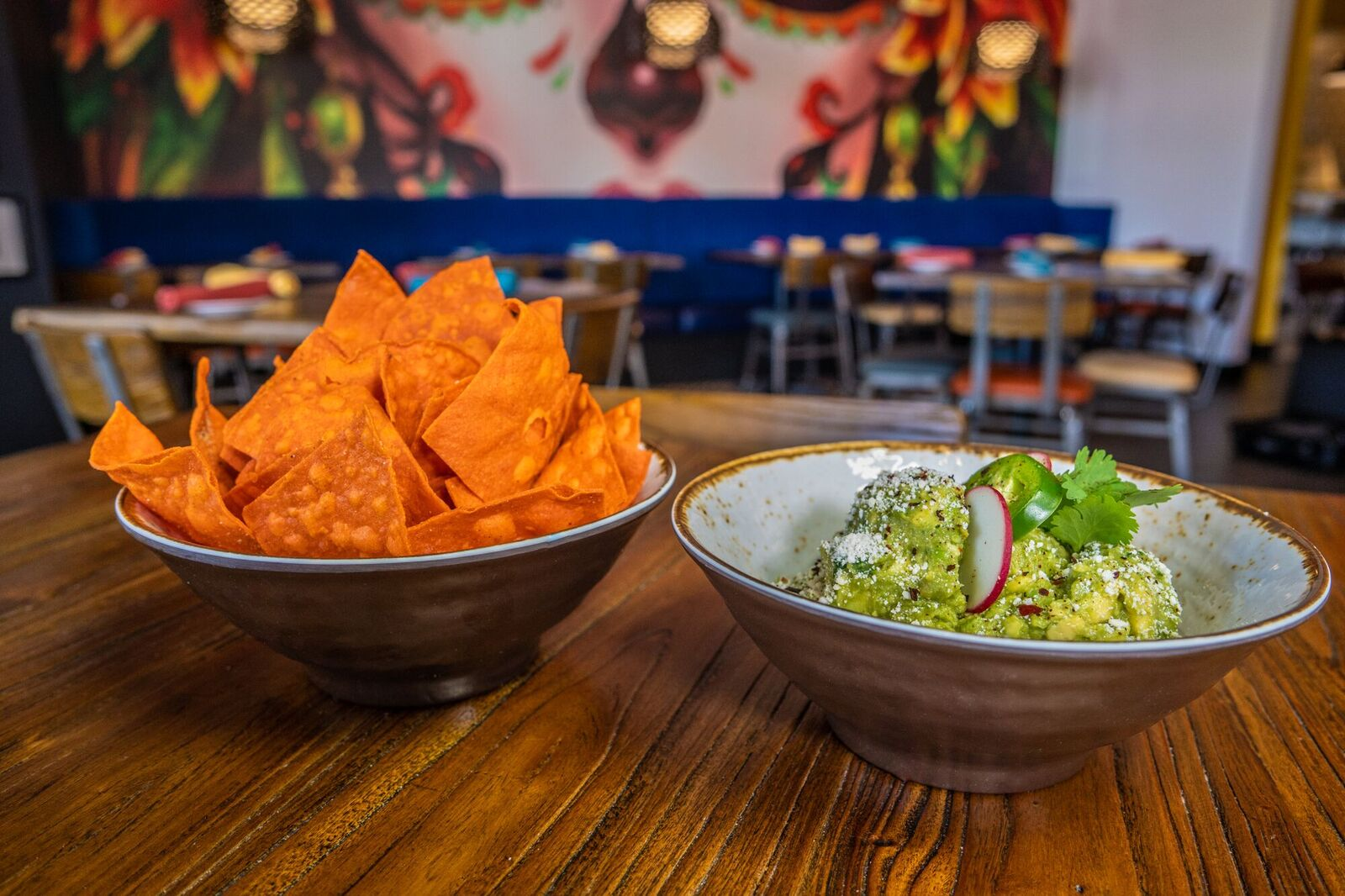 Bowl of guacamole served with a side of chips