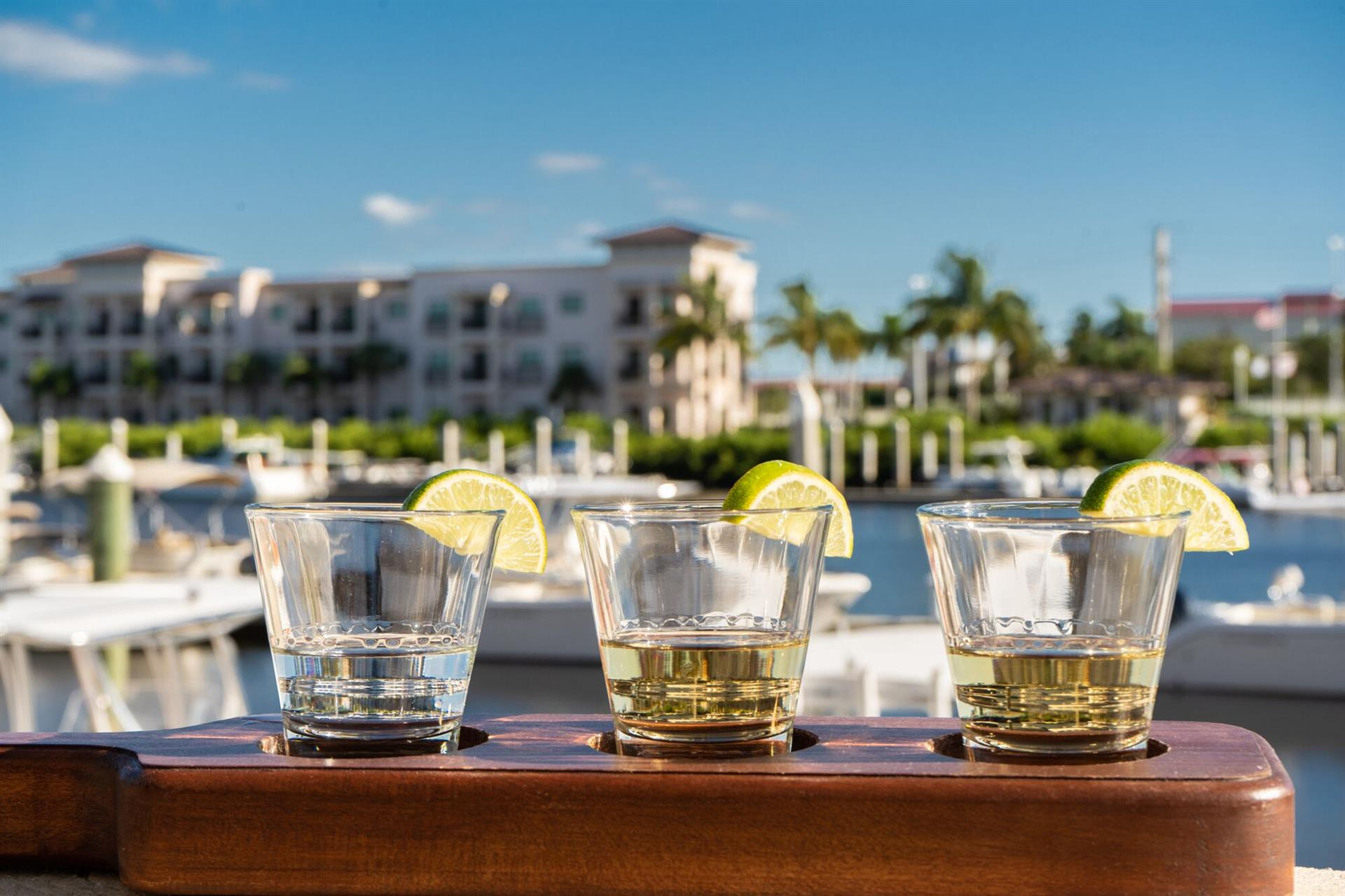 Flight of tequila shots on a ledge over looking the water