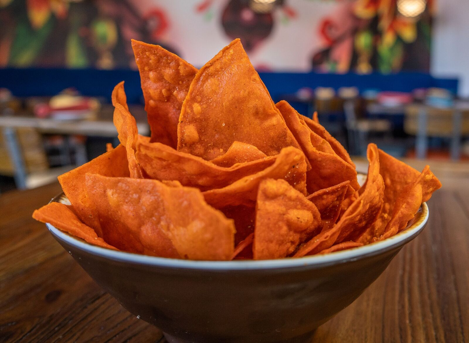 top shot of a bowl of twisted ancho chili-infused corn tortilla chips