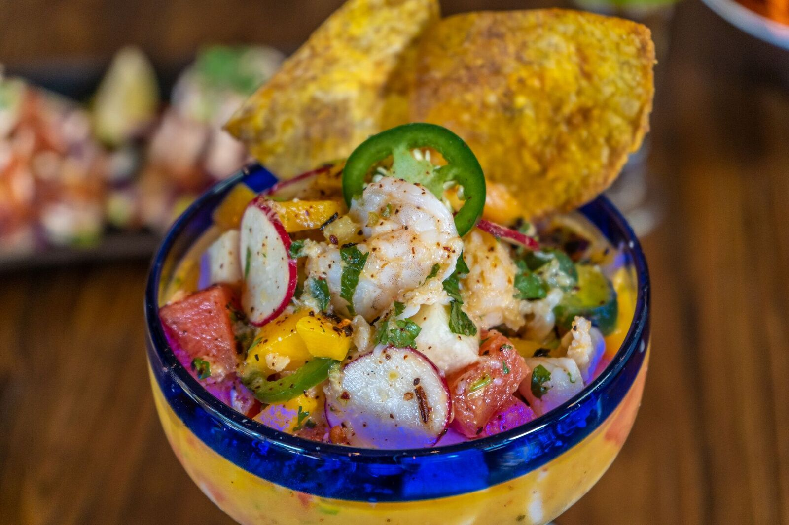 gulf grouper & shrimp cooked with fresh citrus juices, watermelon, mango, jalapeño, pineapple, radish, red onion, jicama & passion-fruit habanero-ginger sauce in a margarita glass