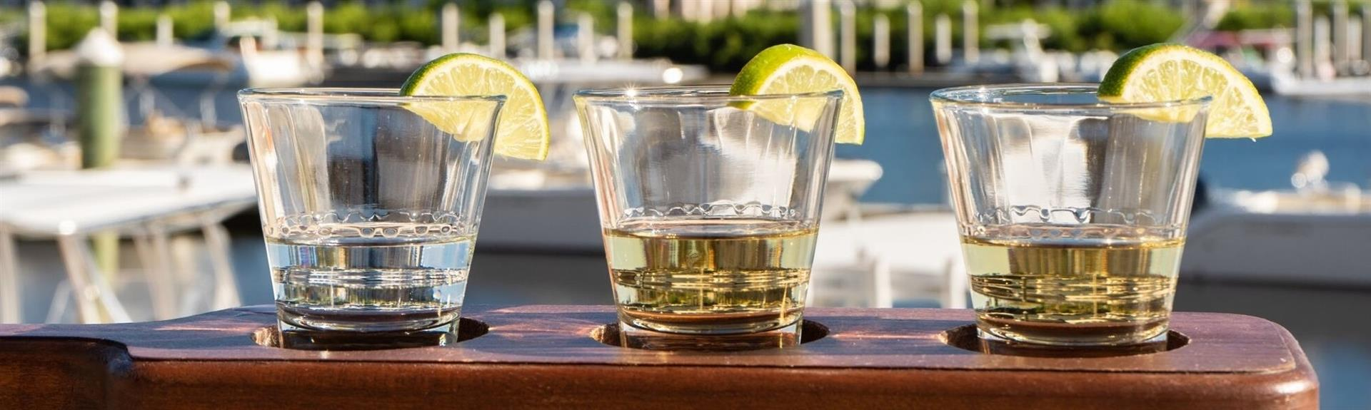 flight of tequila shots with limes