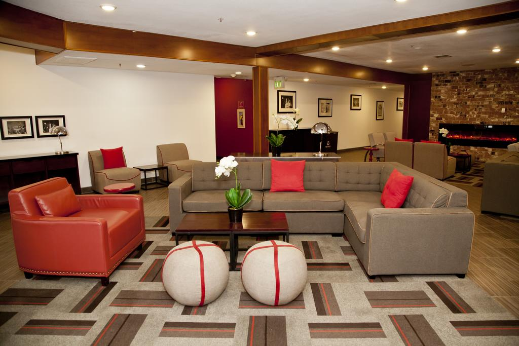 hotel lobby with modern decorations, couches and chairs