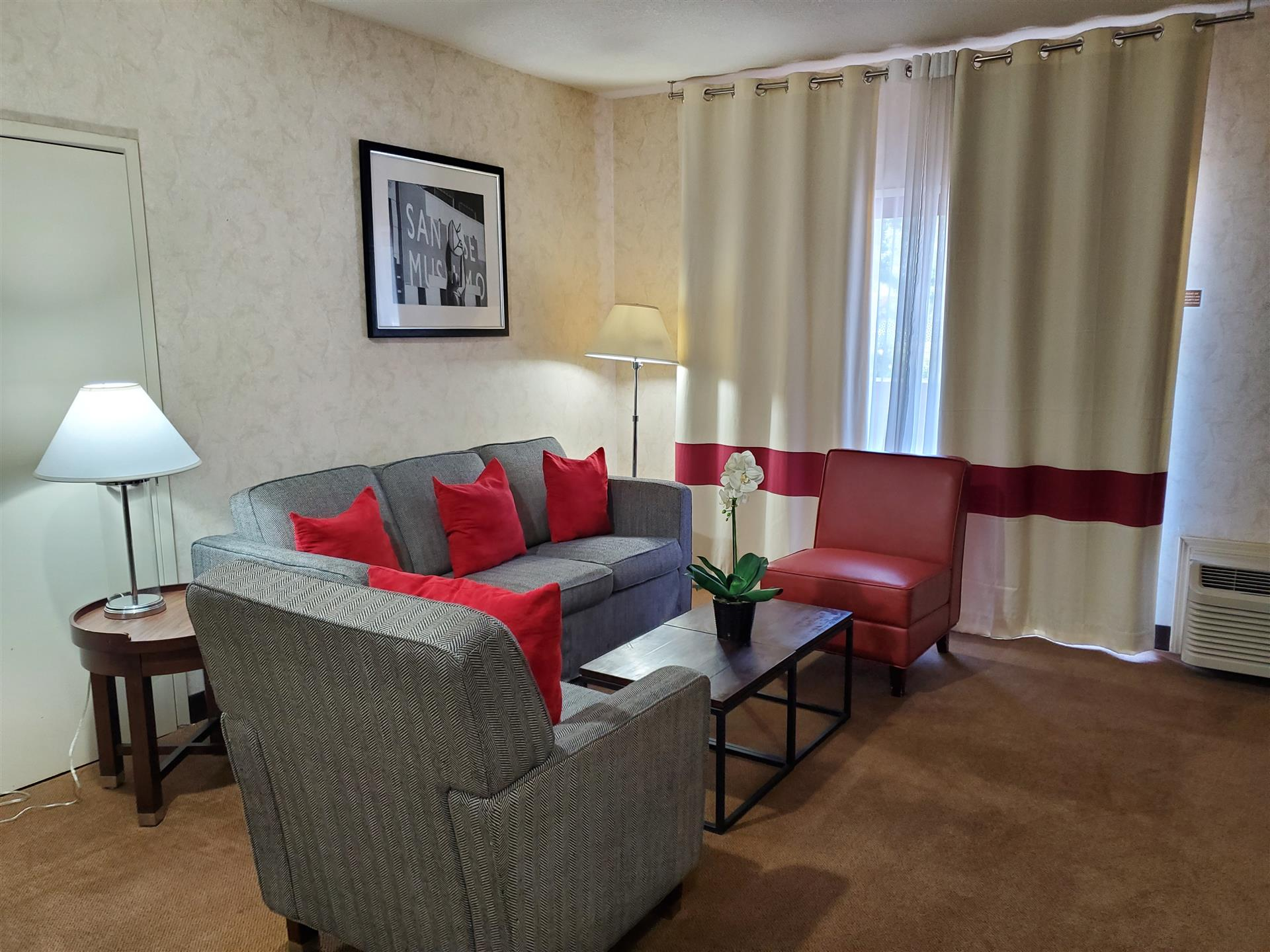hotel room with couches, tables and chairs
