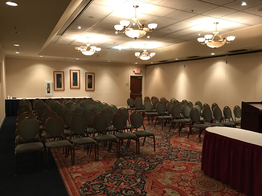 indoor private event room with chairs lined up for an audience