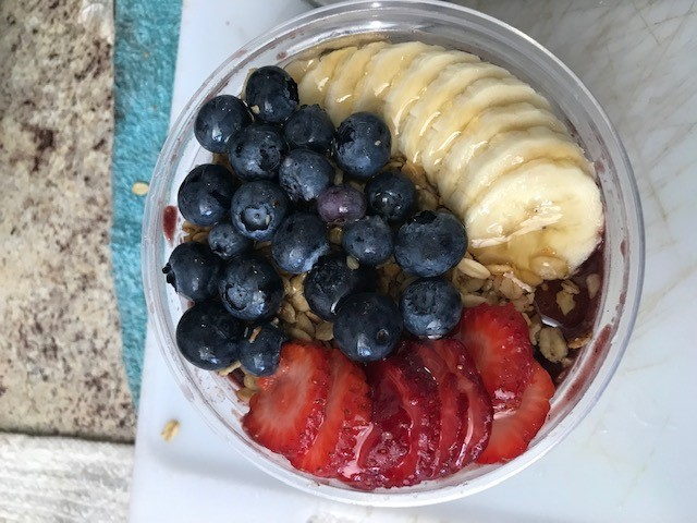 acai bowl with pineapples, bananas, blueberries, and strawberries