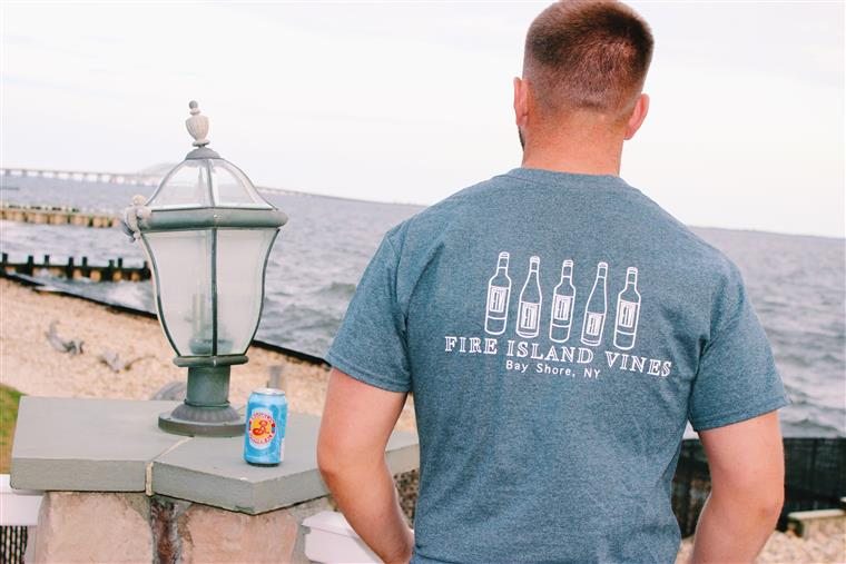 man wearing a Fire Island Vines Heather Grey Tee