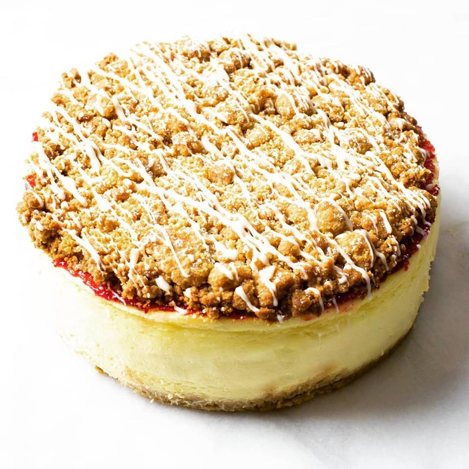 a cheescake with crumbs on it