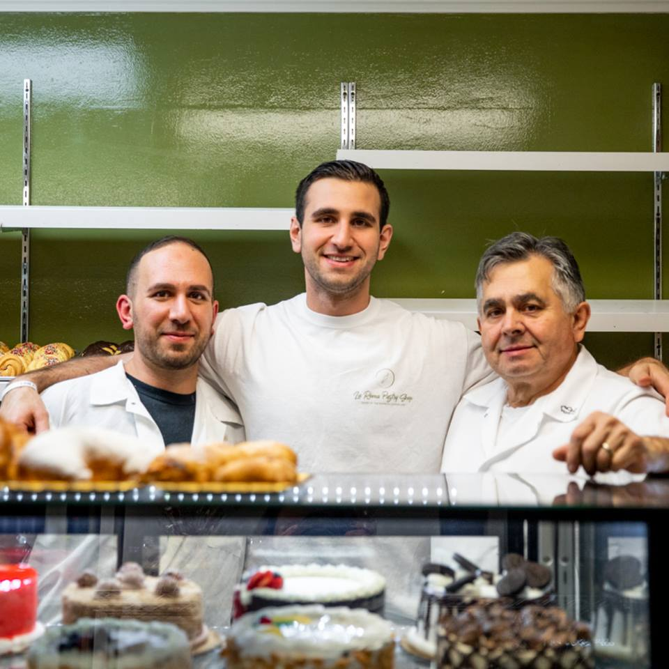 three smiling pastry chefs