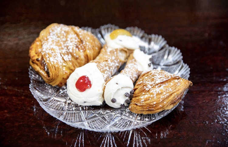 pastries & cannolis on a plate