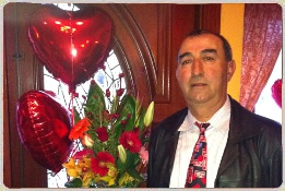 man holding a bouquet of flowers and heart shaped balloons