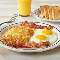sunny side up eggs with bacon, toast and orange juice