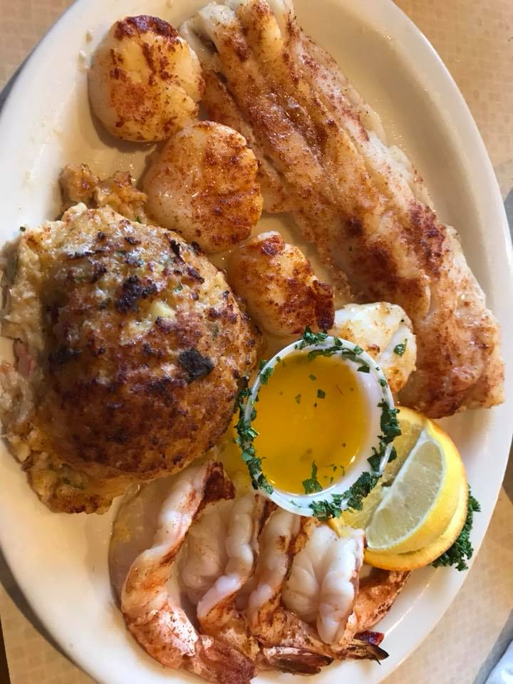 broiled seafood combo with melted butter