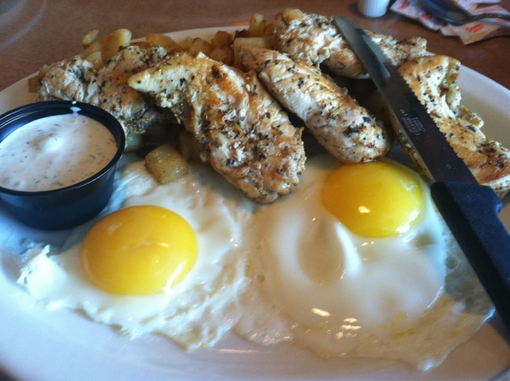 sunny side up eggs with chicken souvlaki and a creamy dipping sauce