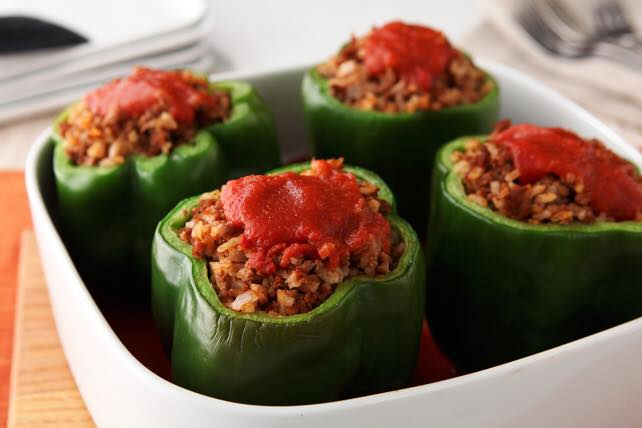 stuffed peppers with tomato sauce on top