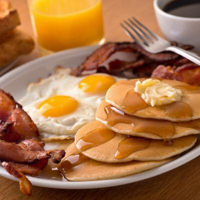eggs, bacon and pancakes with butter and syrup