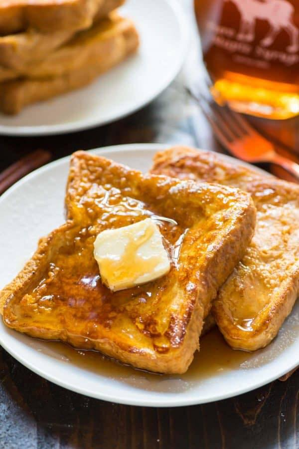 french toast with pats of butter and syrup