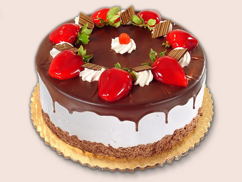 chocolate and vanilla cake with strawberries on top