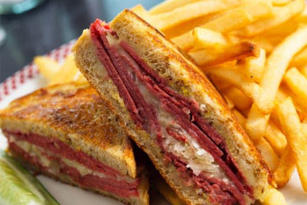 cuban sandwich with coleslaw and french fries