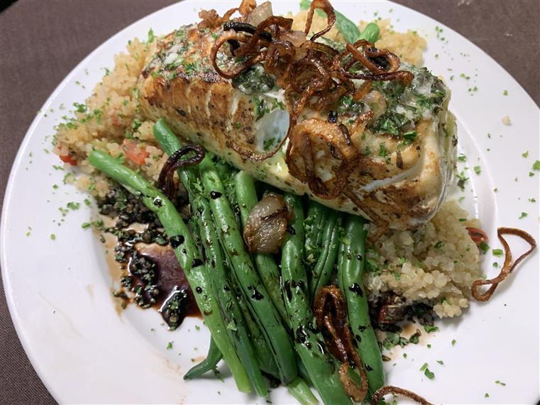 Fried Halibut with string beans over a bed of rice
