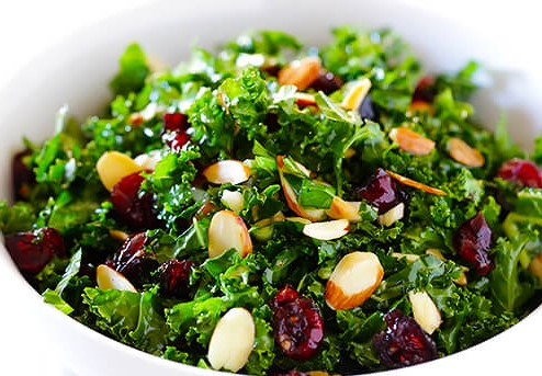 kale salad with almond slivers and cranberries