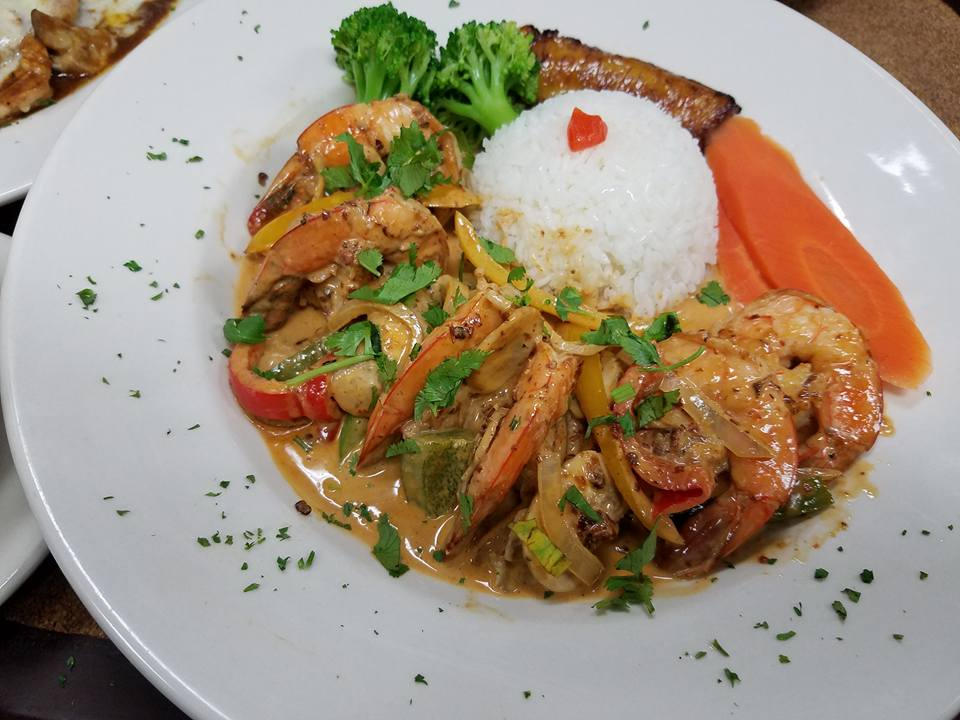 Shrimp in a sauce with a scoop of rice