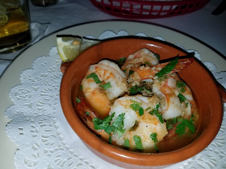 Shrimp in an orange bowl covered in cilantro